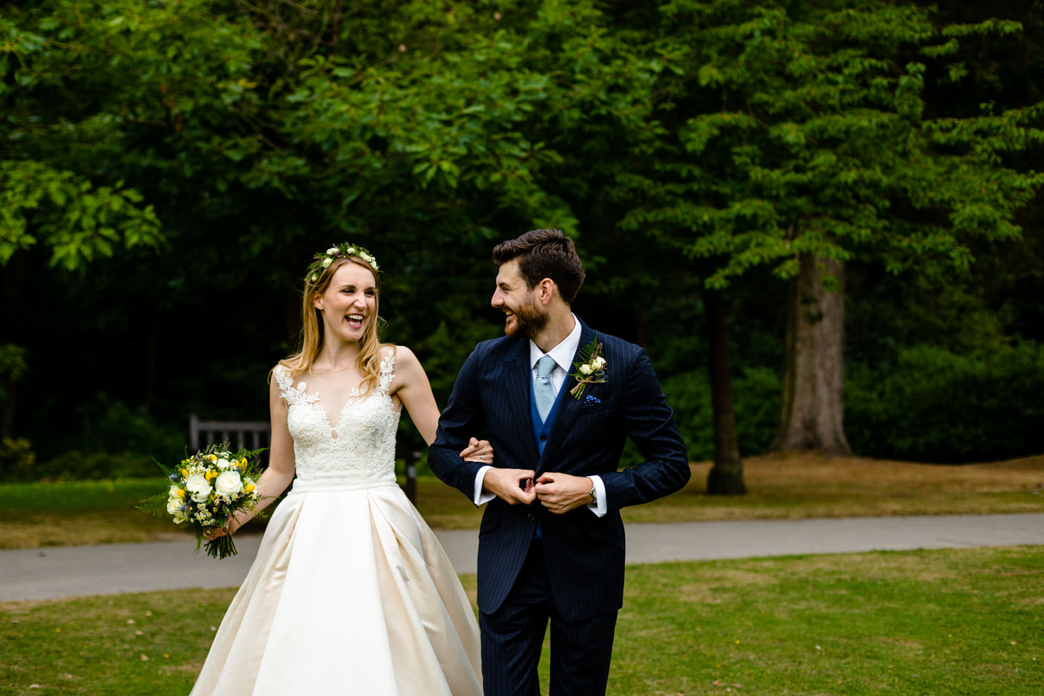 A bride and groom laughing as they walk, Whirlowbrook HallSheffield wedding photography