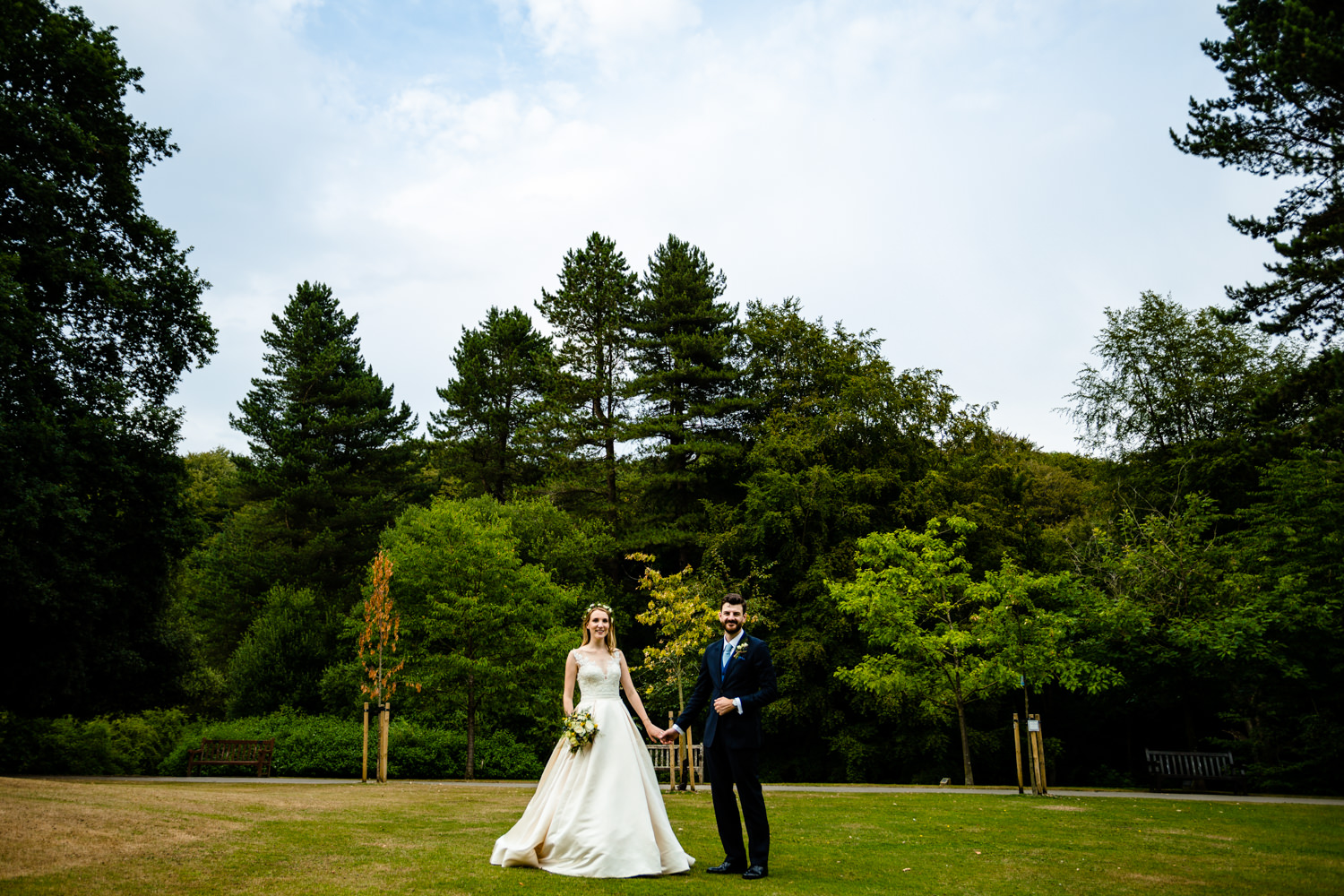 Bride and groom stood in the garden, Colourful Whirlowbrook Hall photographer