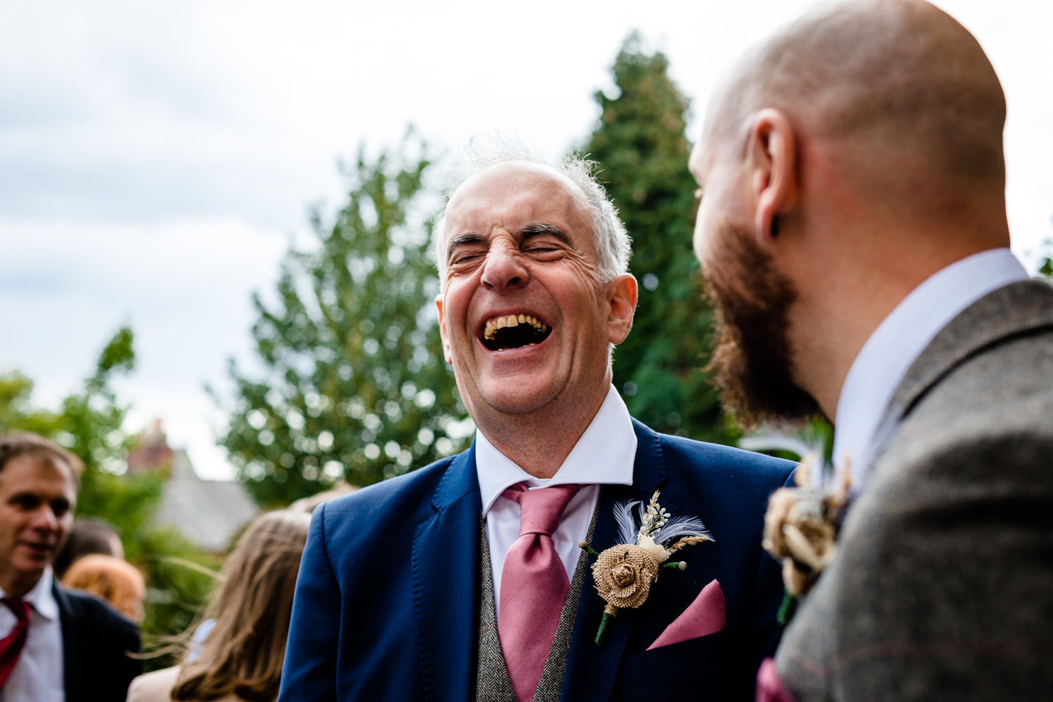 Laughng father of the groom, Relaxed Rochdale wedding photograph