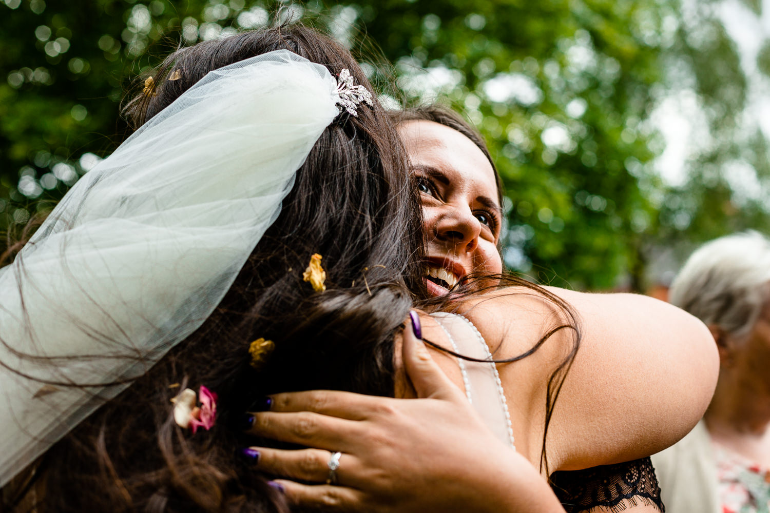 Hugging the bride at a relaxed wedding