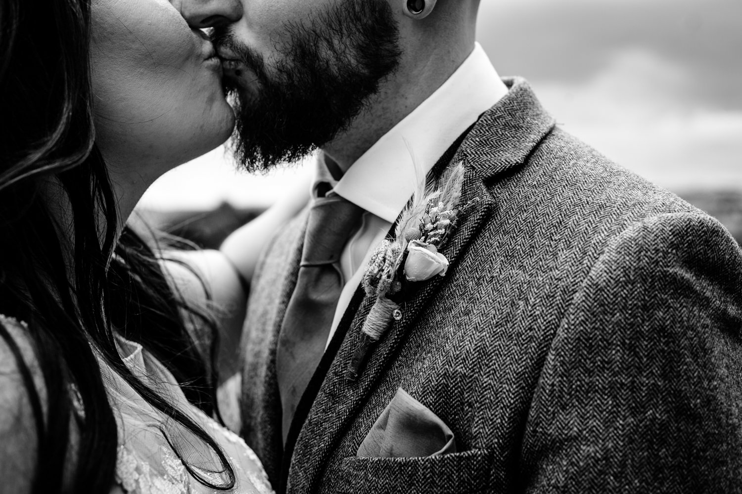 Rochdale wedding photographer, black and white photo of a bride and grooms kiss.