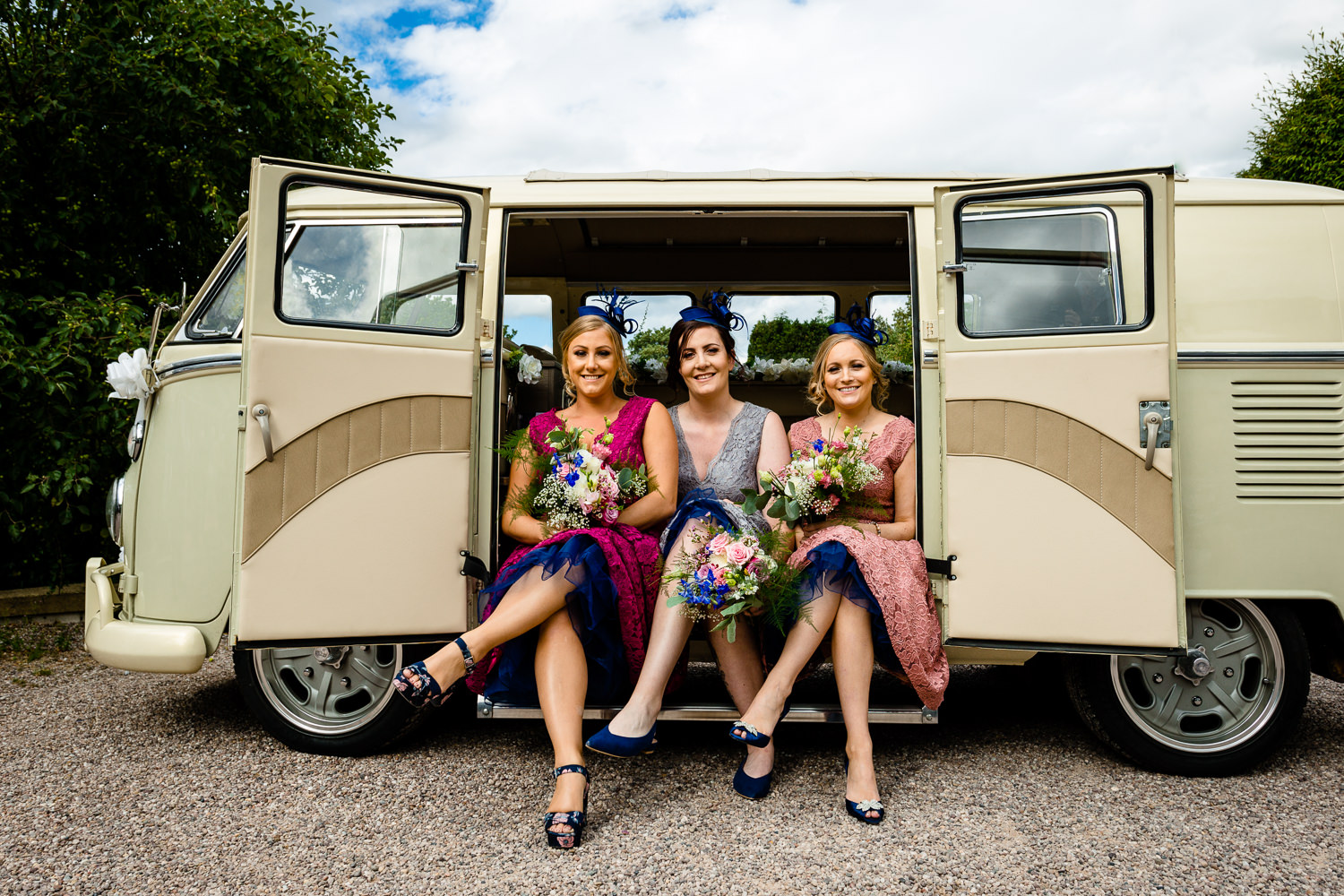Colourful and retro bridesmaids in a vintage wedding VW campervan