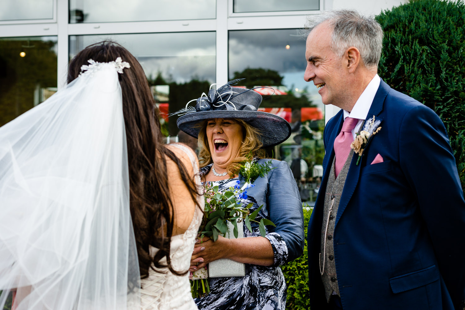 Mother of the bride laughing, Relaxed  Rochdale wedding photographs