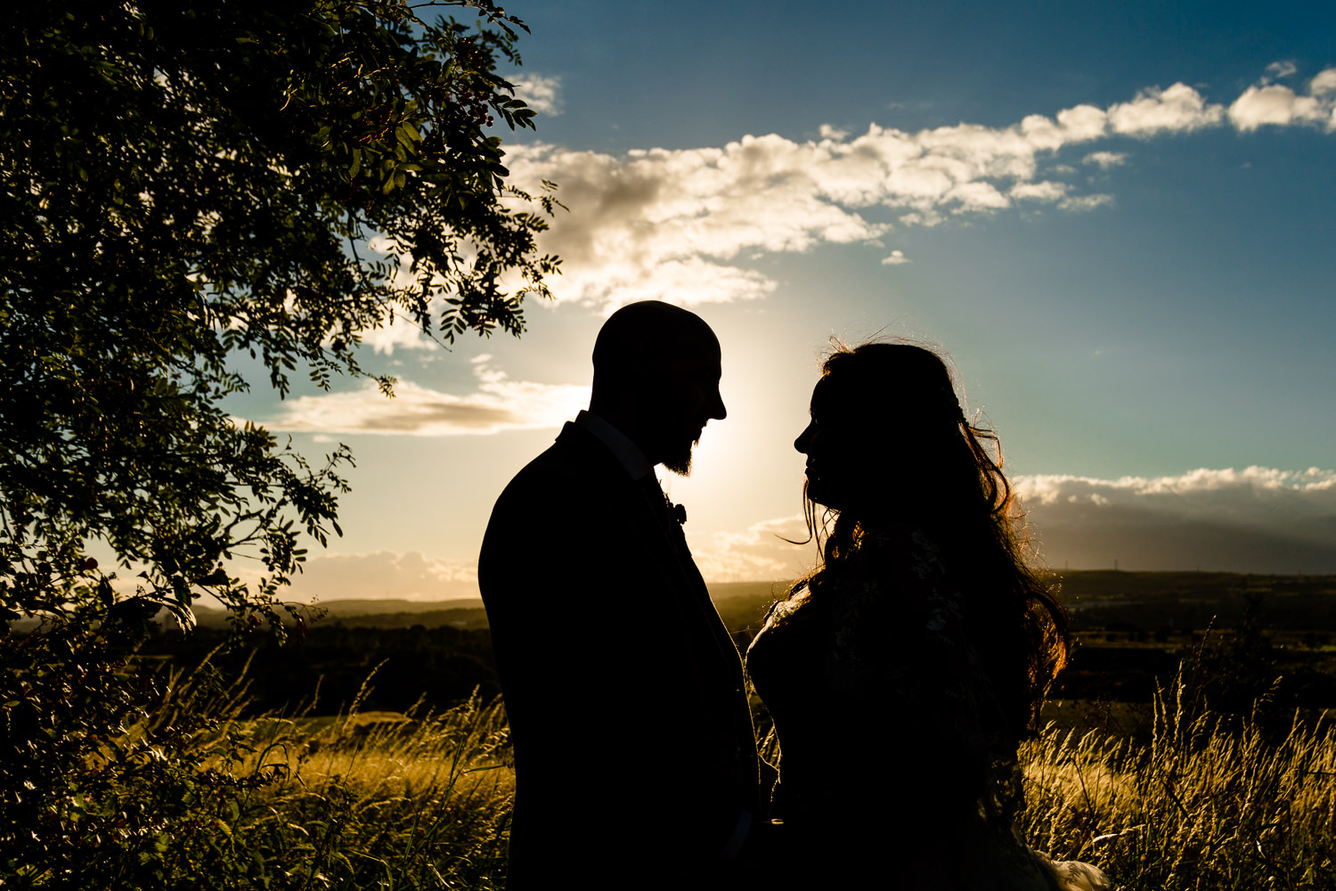 Colourful Rochdale wedding photographer, a bride and groom silhouette at sunset