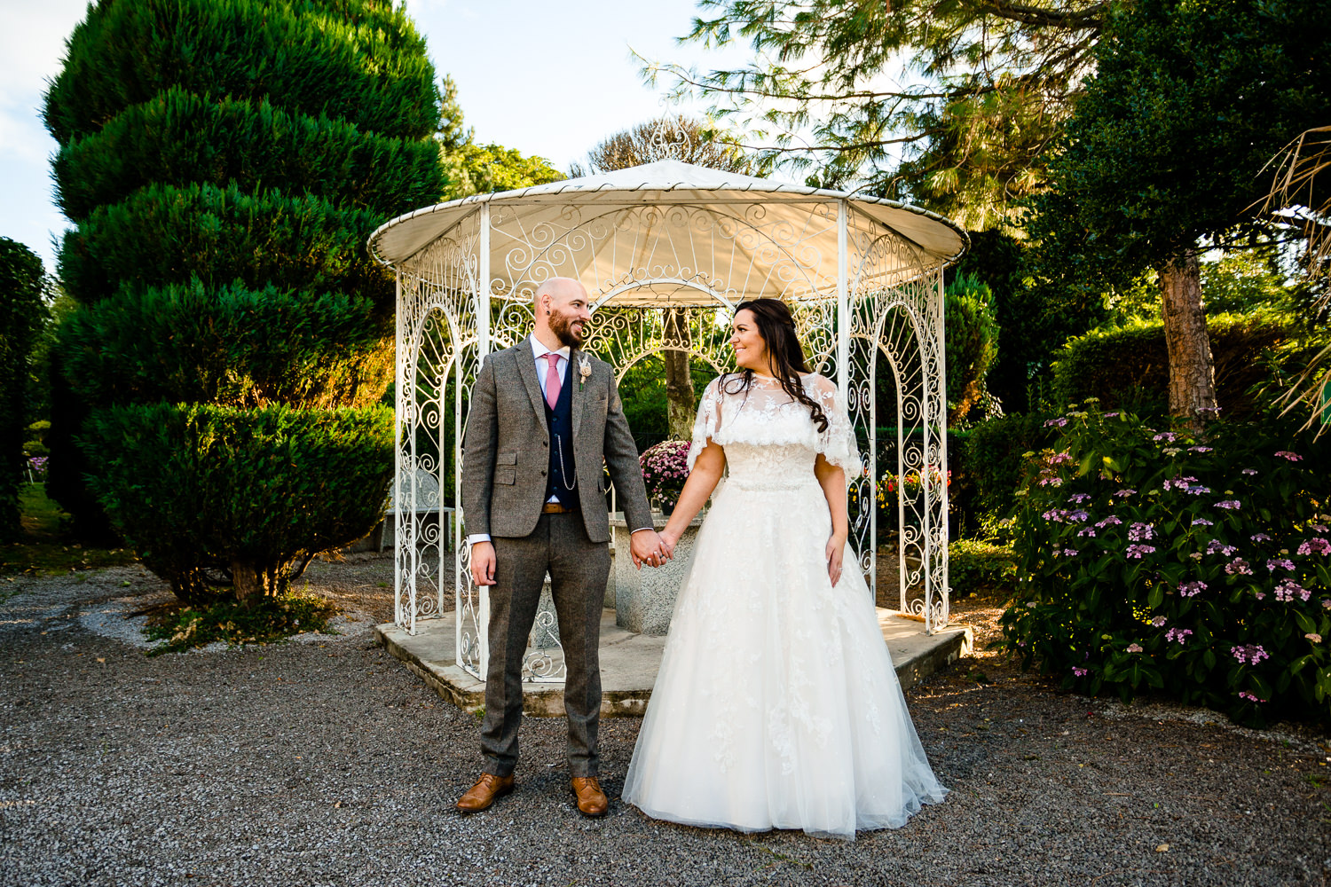 Rochdale wedding photographers, bride and groom in the garden at Bellavista Restaurant