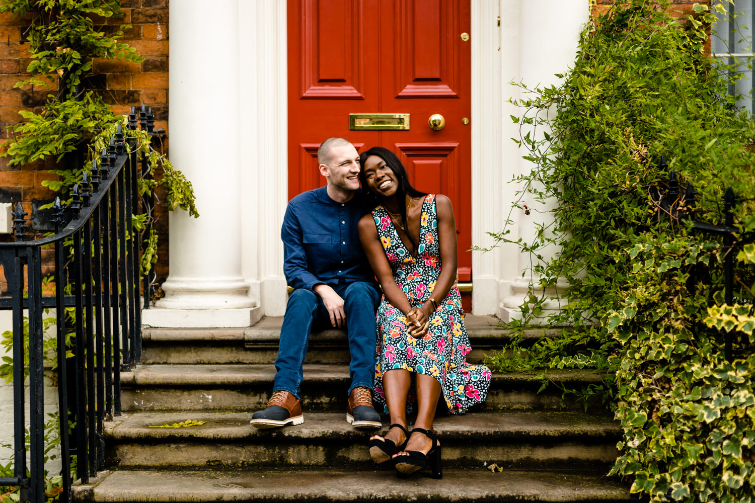 A couple sat on colourful doorstep, creative wedding photographs Liverpool