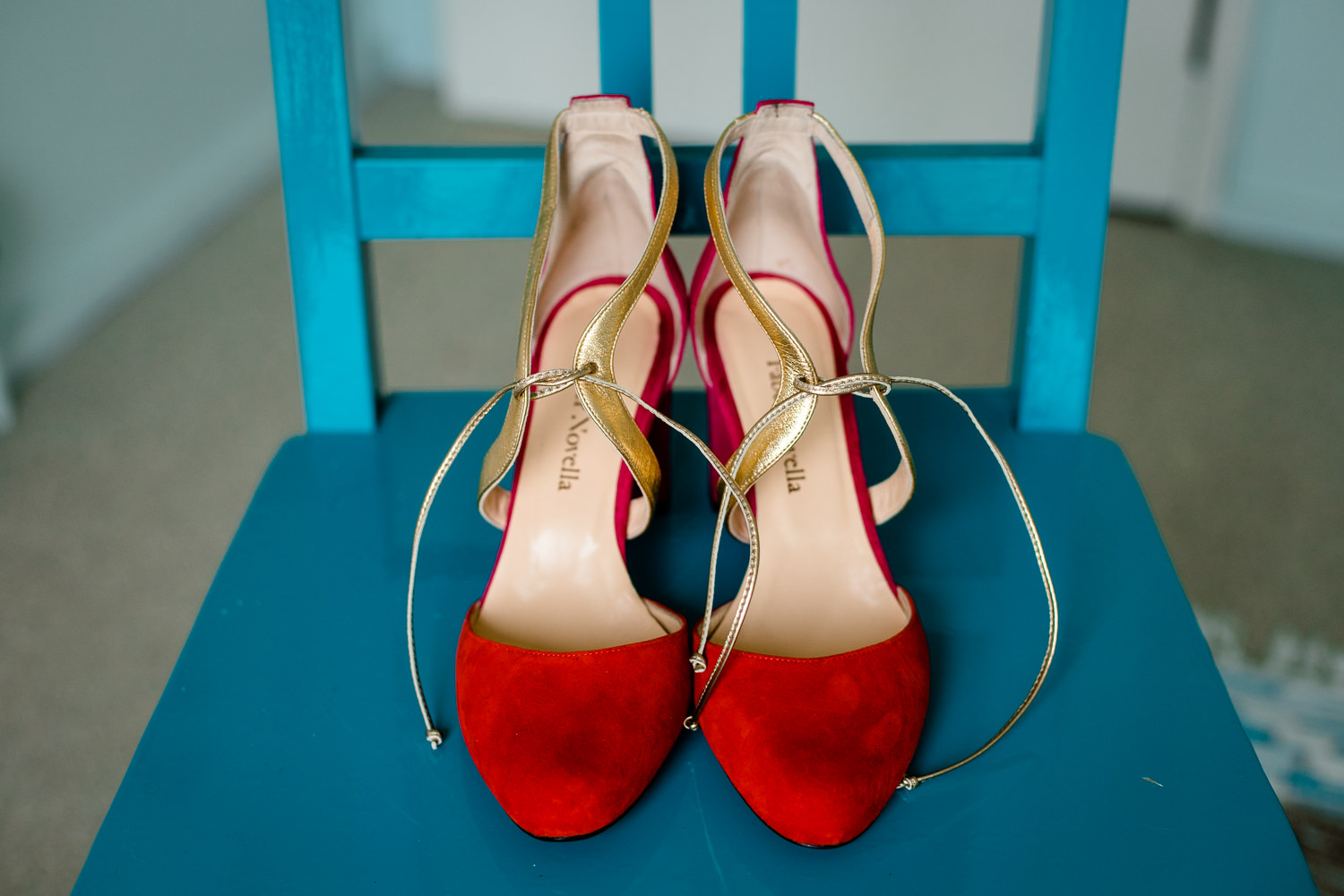 Gorgeous bright red wedding shoes by Faber Novella, wedding photographs Anglesey