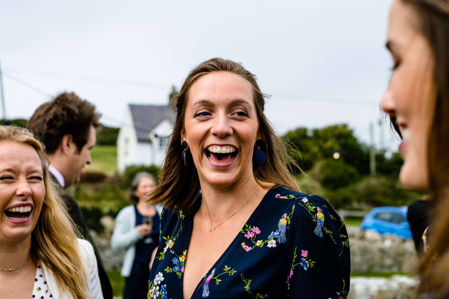 Laughing guests, relaxed Anglesey wedding photographers