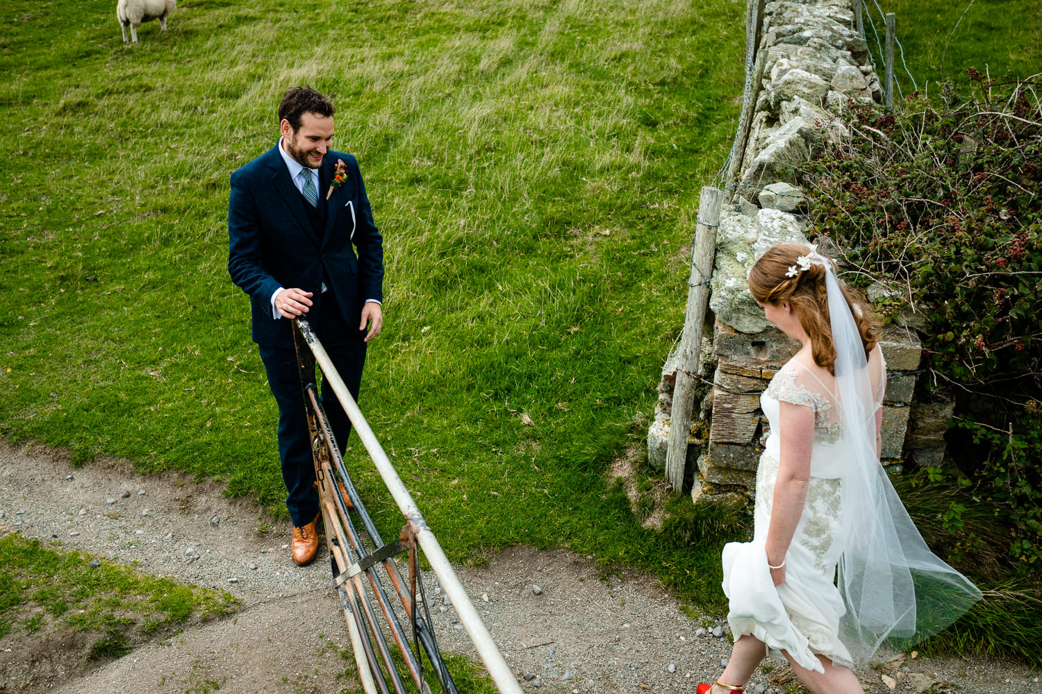 A newly married couple explore the headland, wedding photography Anglesey