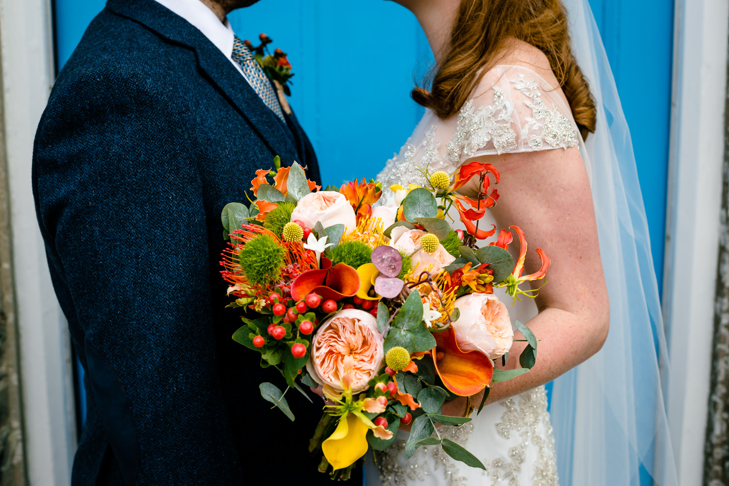 Bright and colourful flower bouquet, Colourful Anglesey wedding photograph