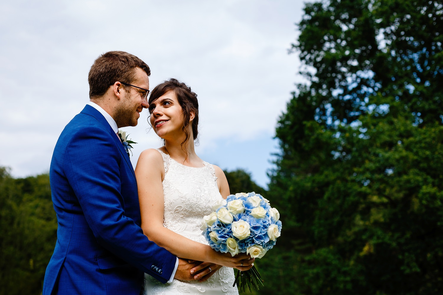 A bride and groom embrace on the lawn at Whirlowbrook Hall Sheffield wedding photography