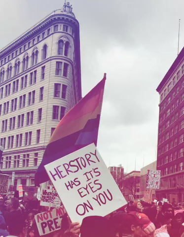 "Sign: ""Herstory has its eyes on you"" - a feminist twist on a popular line in the Broadway musical,  Hamilton . Women's March Bay Area - Oakland, CA."