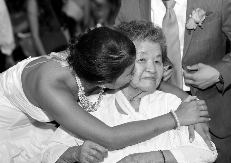 Photo of my grandmother and me at my wedding in July, 2013. Two months later, she passed on at age 80.