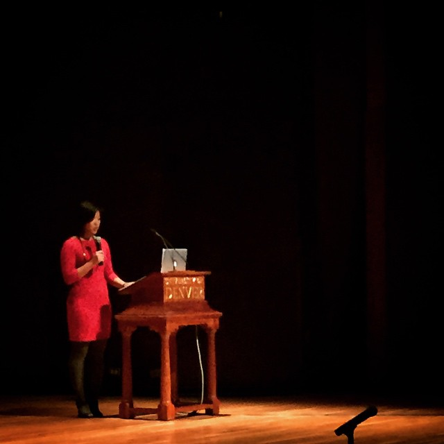 Photo of me at my first major research talk at the 2015 University of Denver Diversity Summit.   This is a photo of my first major talk on Southeast Asians in Education in front of an audience of 400+ in 2015. It highlights one of the first moments of becoming comfortable with my platform and using it for the good of our community.