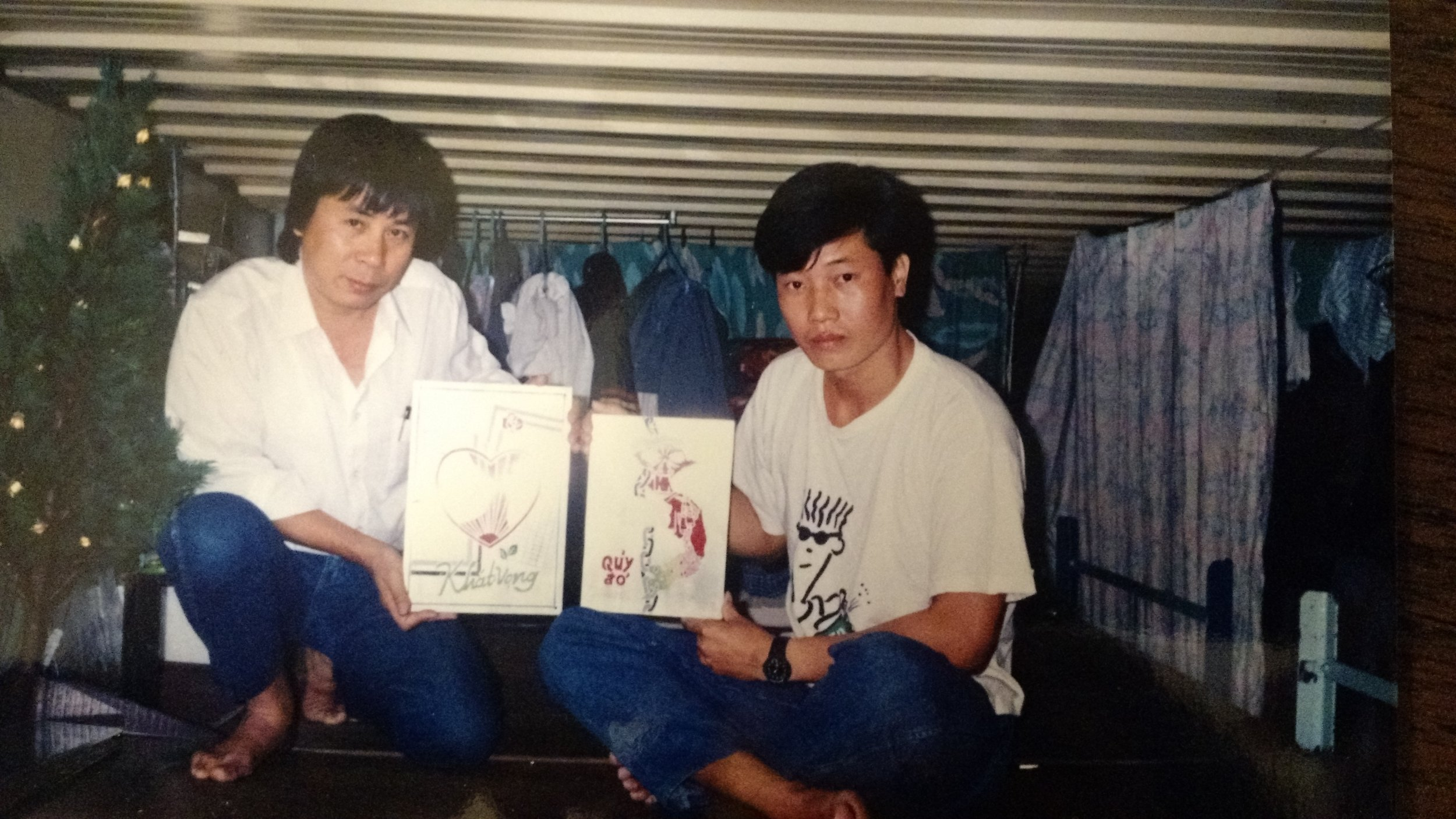 Credit: BPSOS Archives. Two men holding their freedom posters.