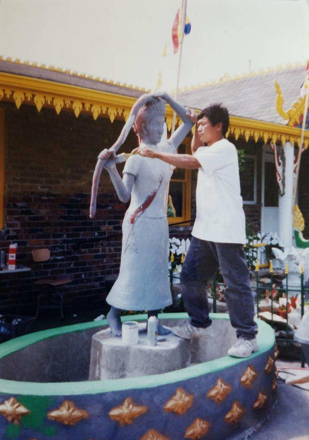 My dad building a buddha sculpture for Wat Lao in Kansas City, MO.