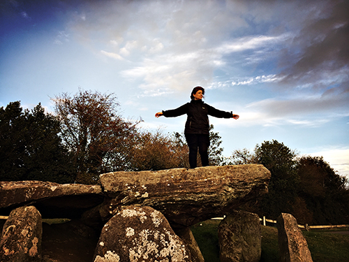 """Paula, rocking a """"You Shall Not Pass"""" groove on Arthur's Stone, a Neolithic chambered tomb, 3,700 BC"""