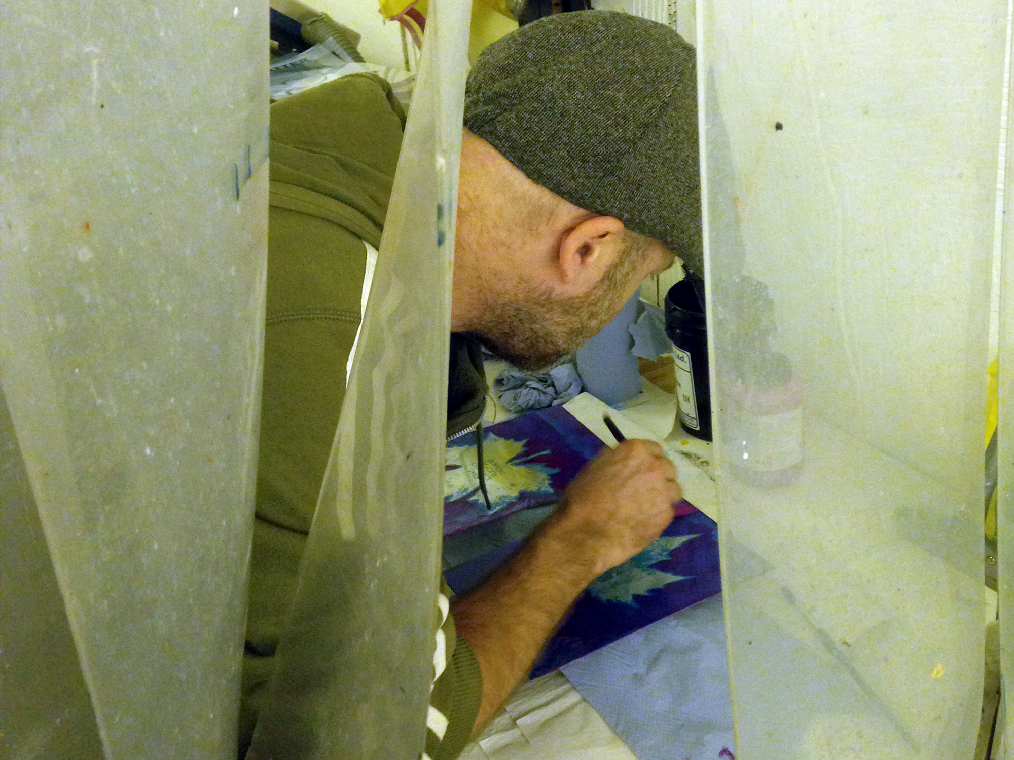 Painting the plate ('stopping out') to protect areas from etching solution