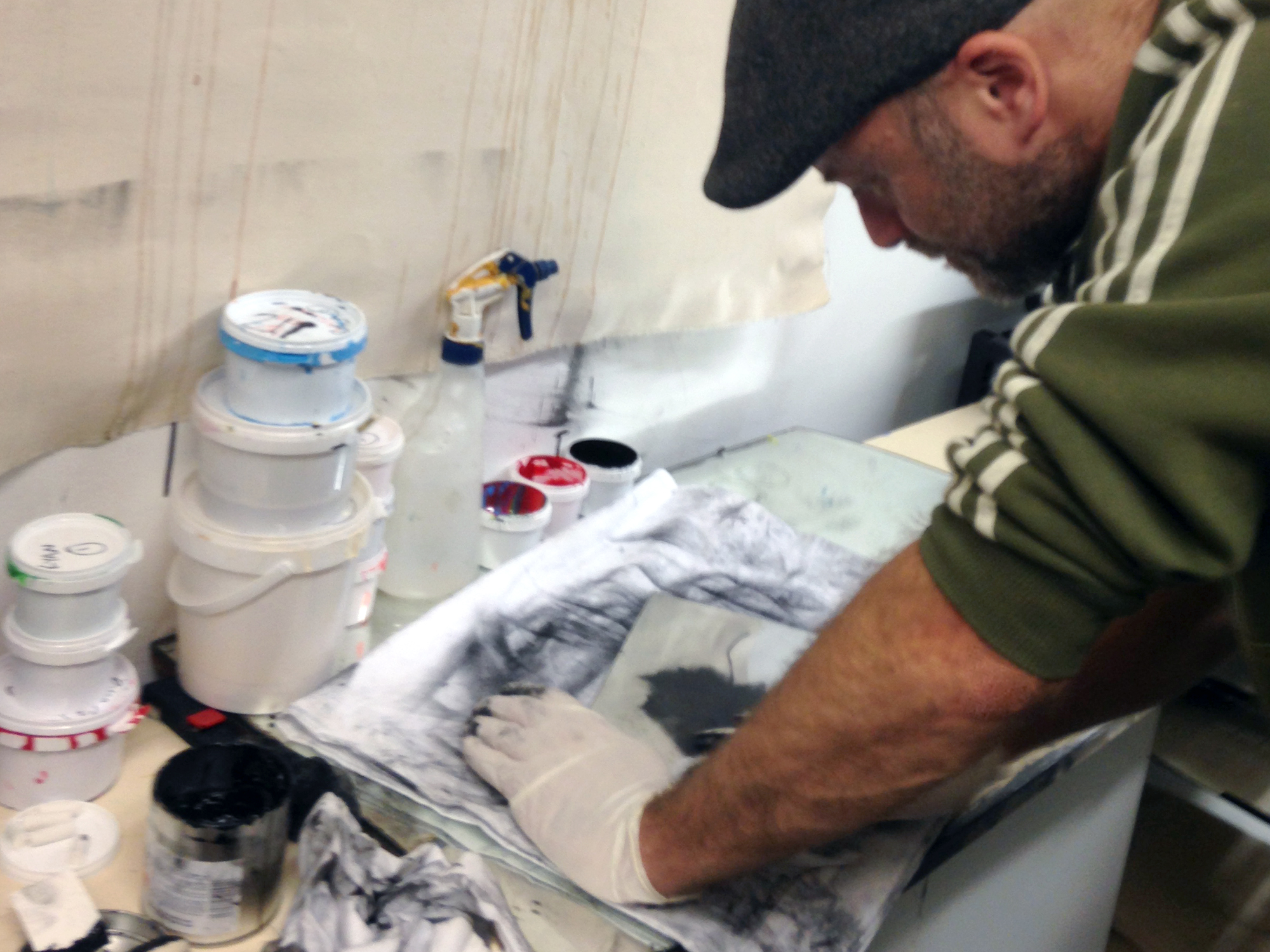 Polishing the plate surface, removing excess ink leaving only the etched area to print