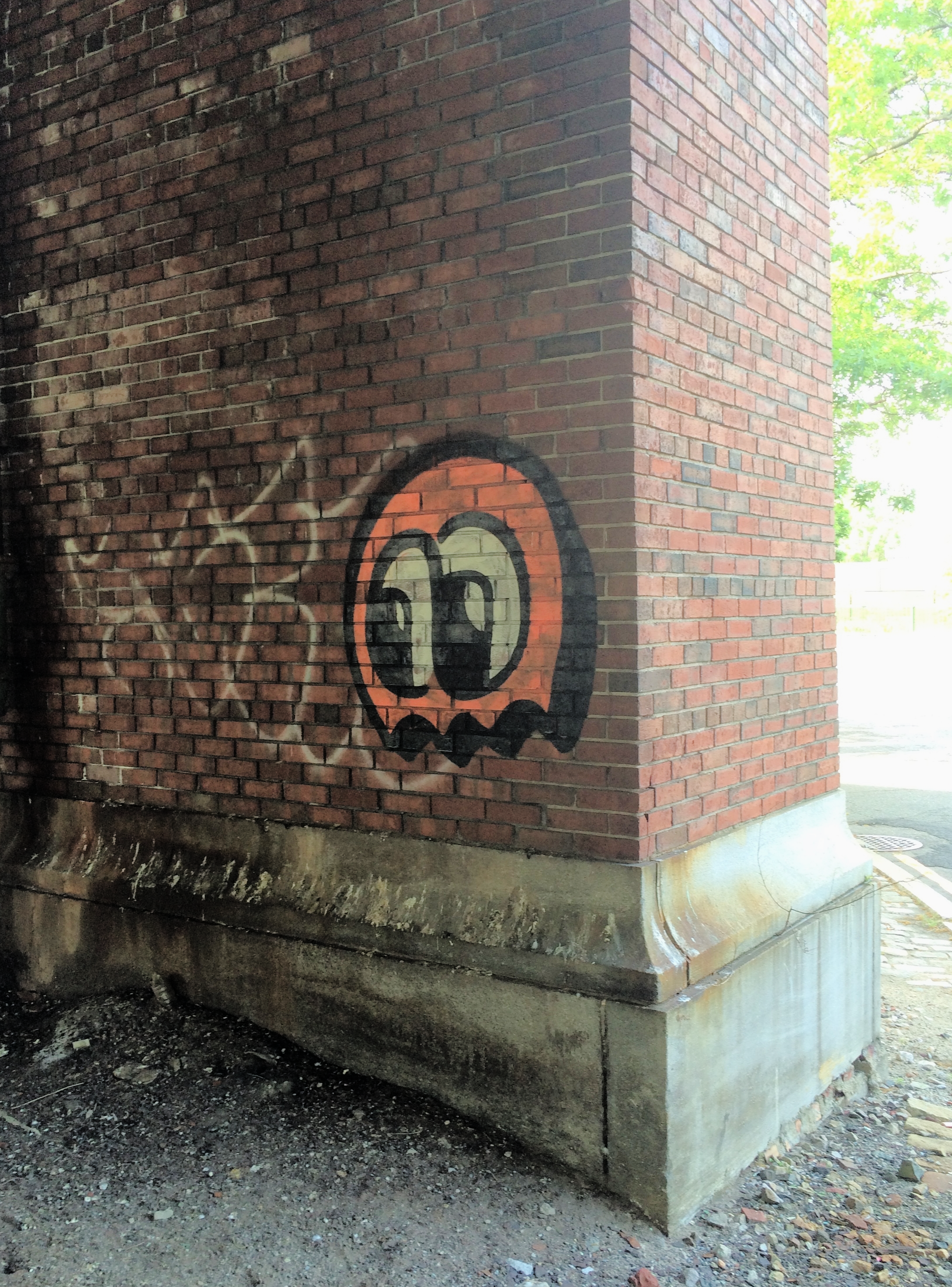 Another tangerine tag haunts the center of the Memorial Drive rotary by the Boston University bridge.