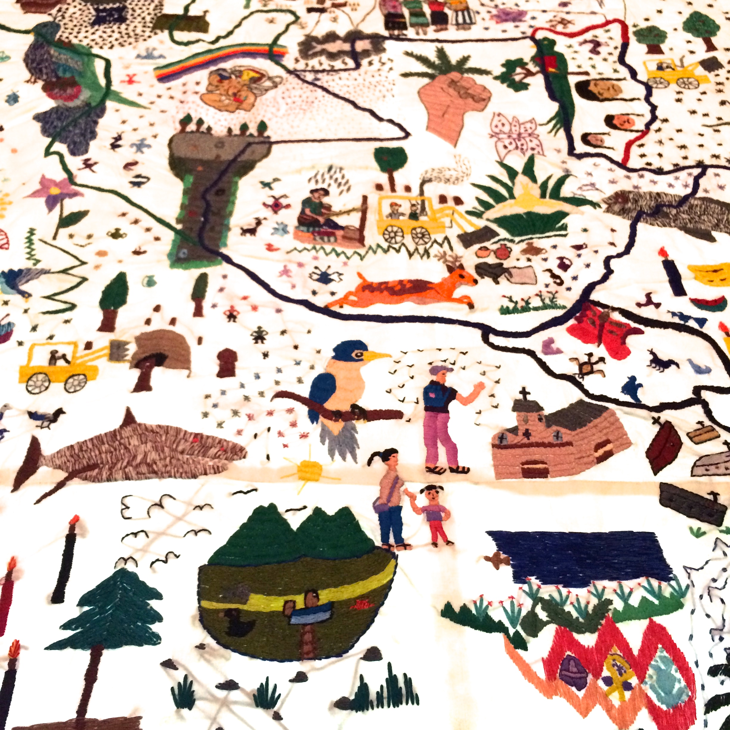 A closely cropped detail of Teresa Margolles, Nkijak b'ey Pa jun utz laj K'aslemal / Opening Paths to Social Justice , 2015. Embroidery on fabric permeated with blood from the body of a woman assassinated in Guatemala City. Created with participation of Mayan women members of the Asociación de Desarrollo de la Mujer K'ak'a Na (ADEMKAN): Bonifacia Cocom, Lucy López, Yuri López, Silvia Menchù, Claudia Nimacachi, Lucrecia Puac, Estela Tax, and Josefina Tuy. 78 3/4 x 18 3/4 in.