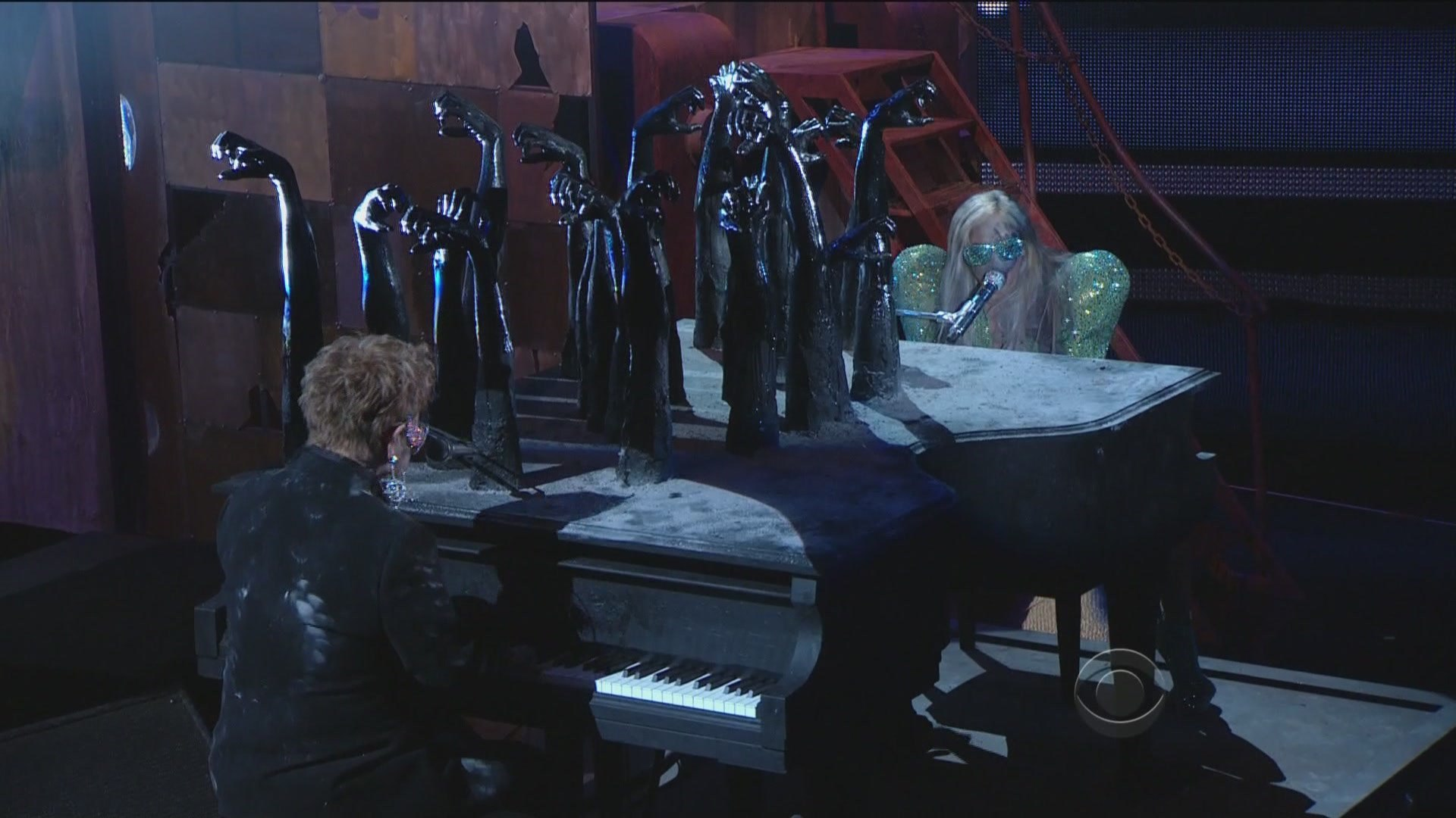 """Terence Koh   Lady Gaga's Burnt Double Piano  (featured in her duet with Elton John during the 2010 GRAMMY Awards) Wood, steel, plastic 80""""x 57""""x 69"""" Photo © CBS"""