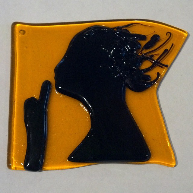 """The Silent Maid logo in glass. 3"""" x 3"""""""