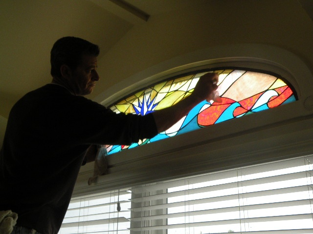 Compass Rose of Cedars Installation  We design, fabricate, deliver, and install all shapes and sizes of stained glass for your home or business. Pictured here is our skilled craftsman putting the final touches on this newly installed panel at a home in Long Beach Island.