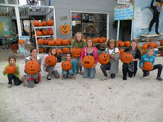 This group participated in Carve Pumpkin Carving Contest hosted by SwellColors in the fall.