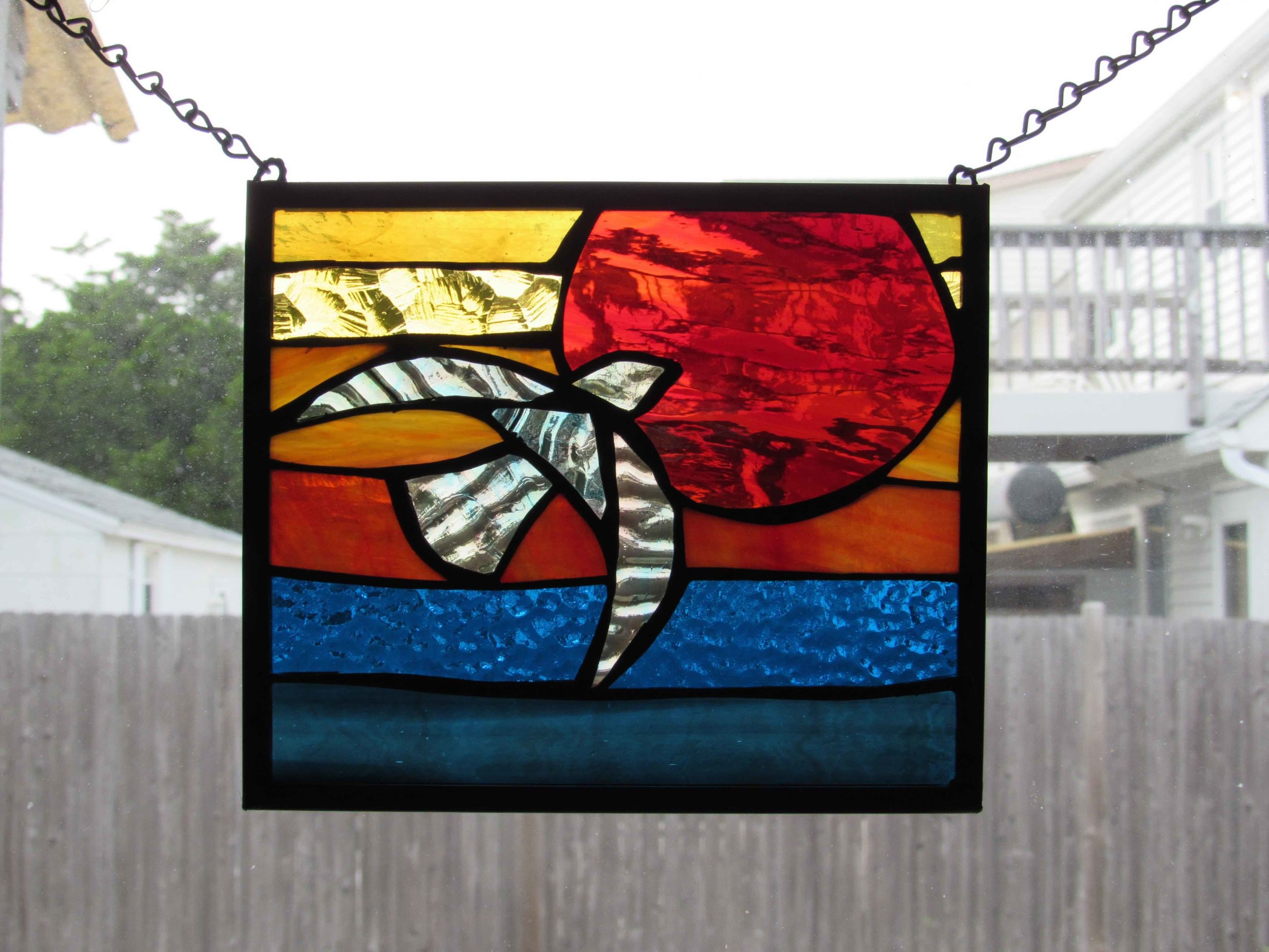 Custom Stained Glass Window.Bird Flying Into Sunset at Sea 2.jpg