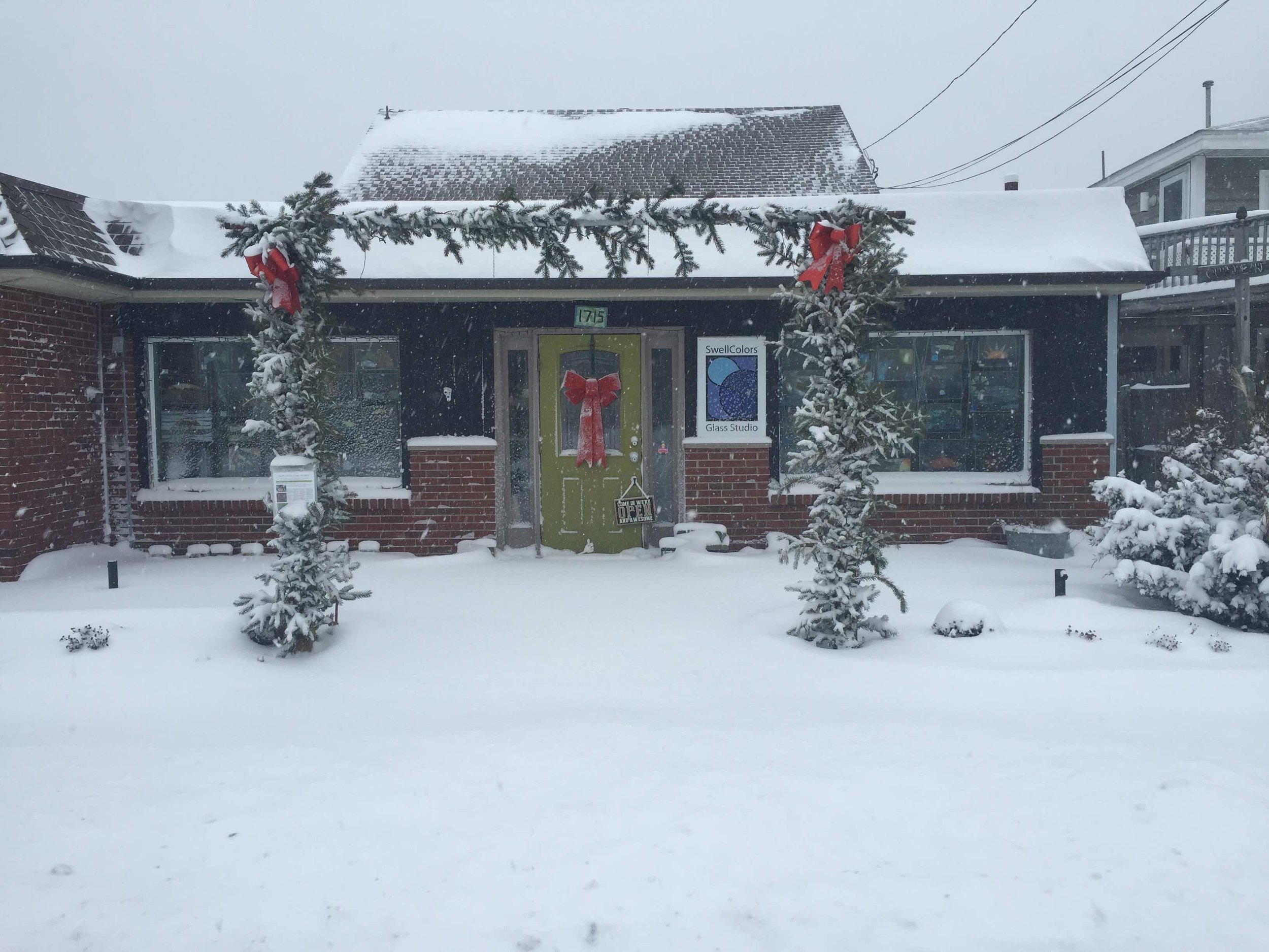 Our flagship in Surf City, SwellColors Glass Studio, looking very merry and bright in all this snow!