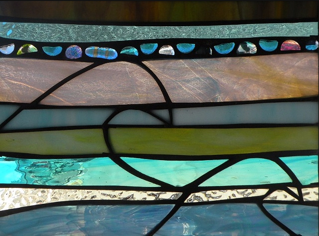 """Winter Sol Stained Glass Window Collection. Design for February 26: """"Bonita Olas""""."""