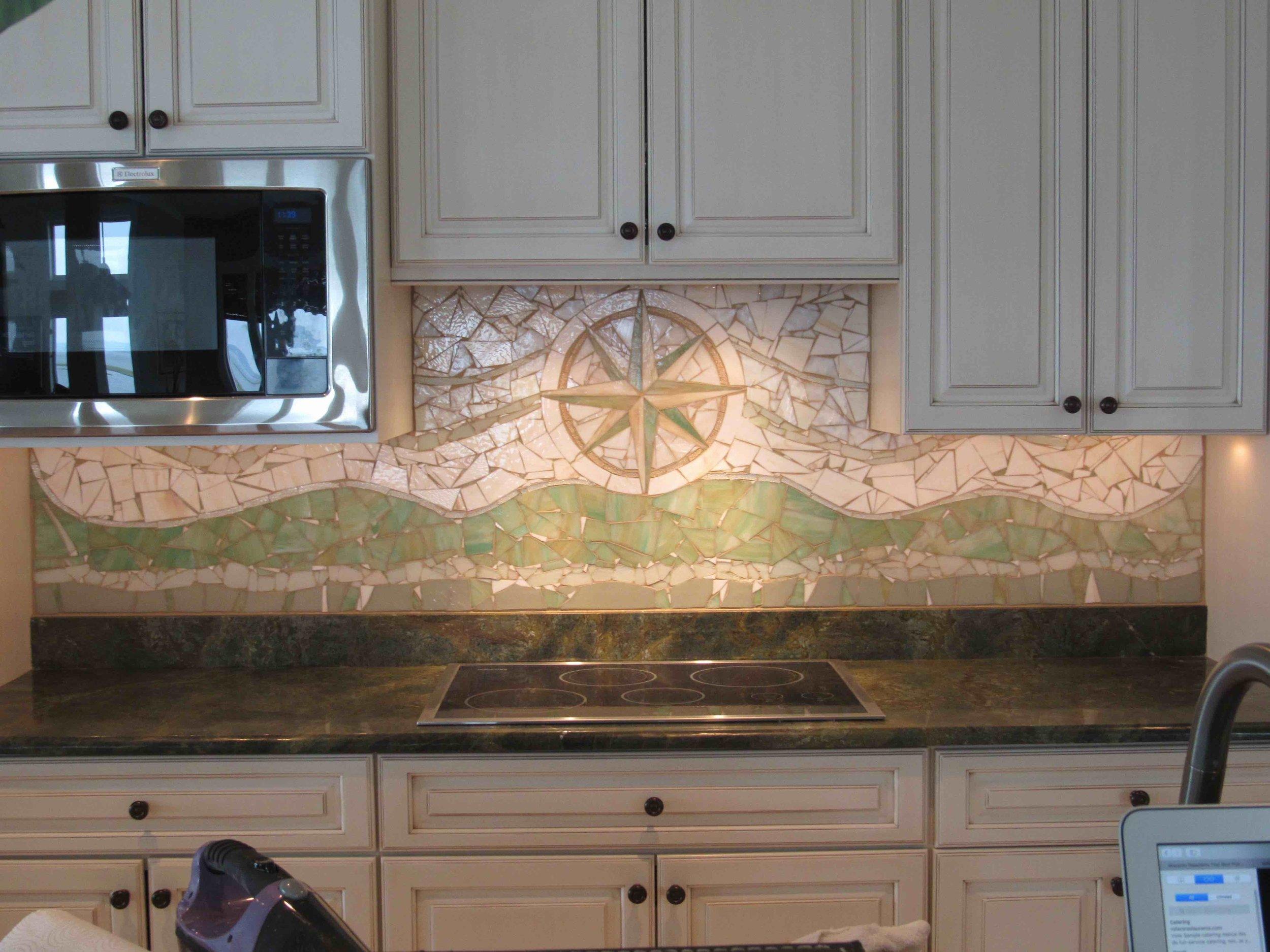 Custom compass rose mosaic backsplash