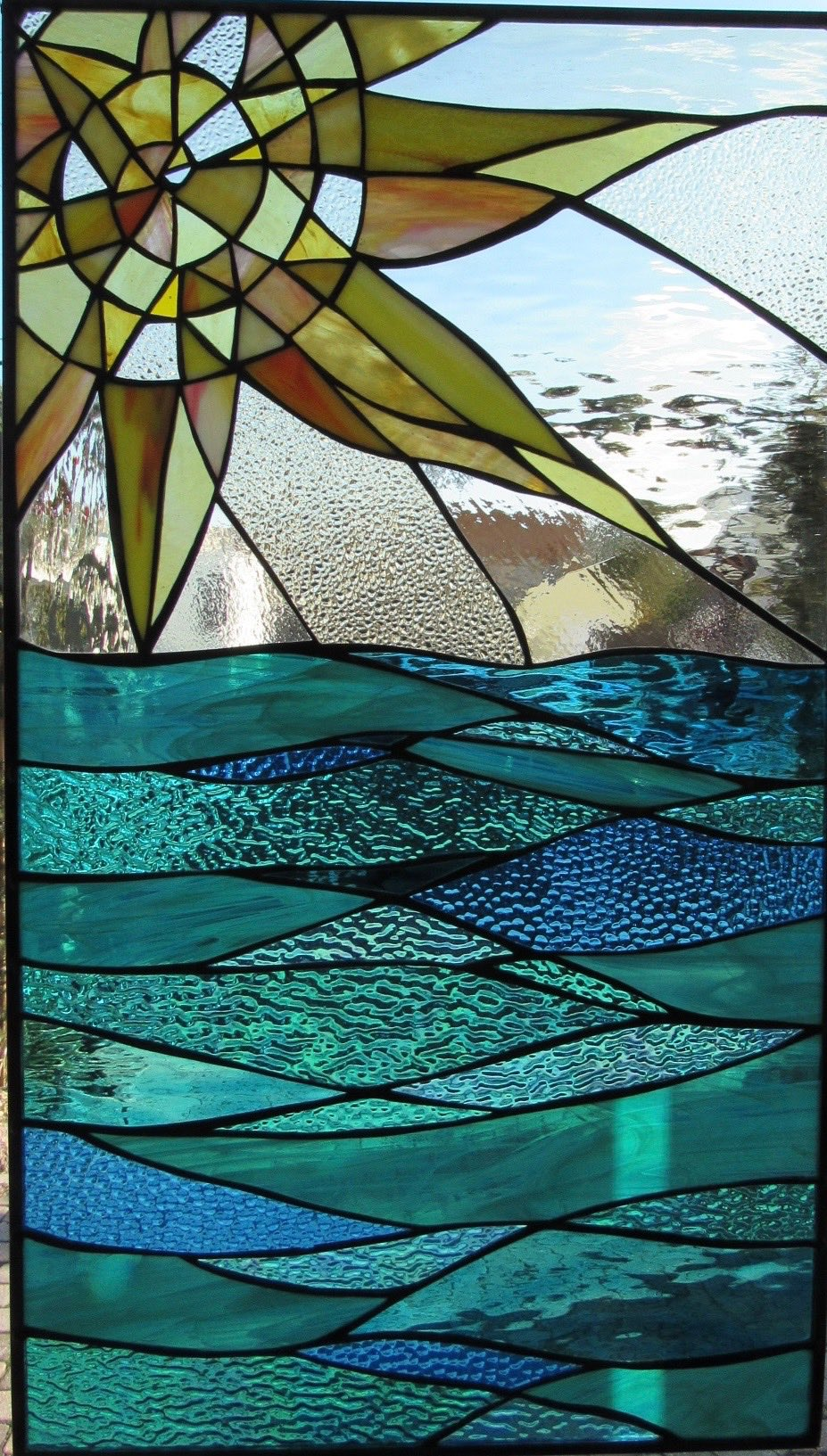 """Sun over Waves"", 2017, custom stained glass by Mary Tantillo."