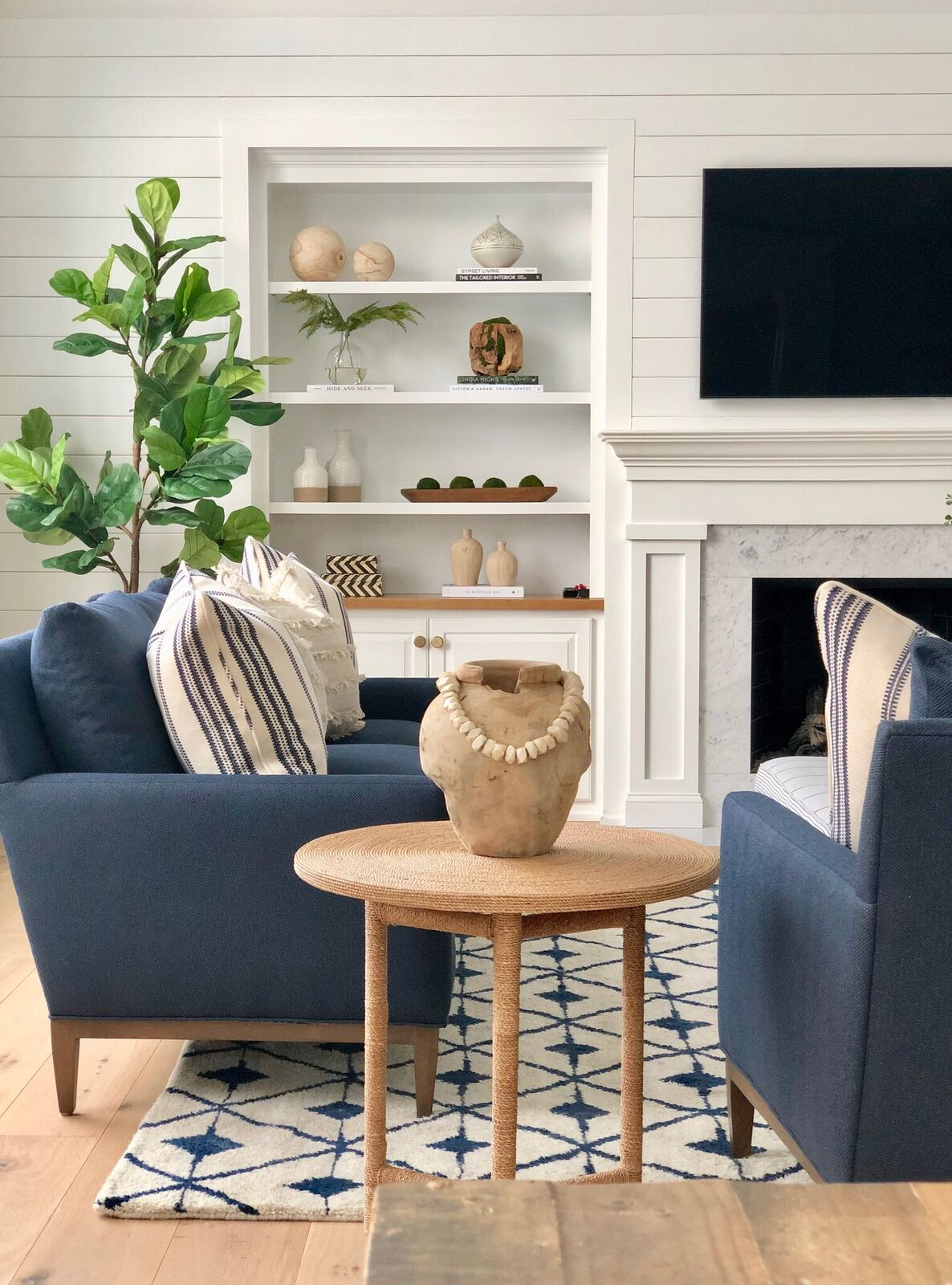stephanie-kraus-designs-mainline-pa-family-room-project-after-styled-bookshelf.jpg