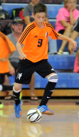 Medeiros    dribbling towards the goal during a pre-tournament match against Australian Futsal's national selection team, in the First Annual Austronesian Futsal Cup in December 2015.
