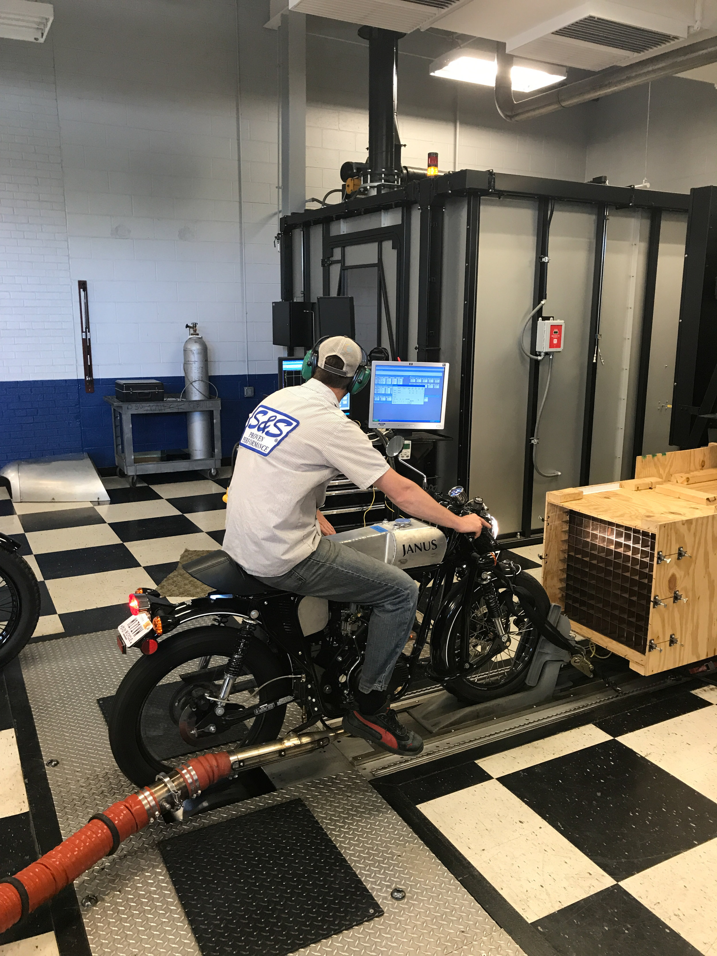 Emissions tech, Matt, onboard the Janus test mule at S&S Cycle's test facility in Lacrosse, Wisconsin.