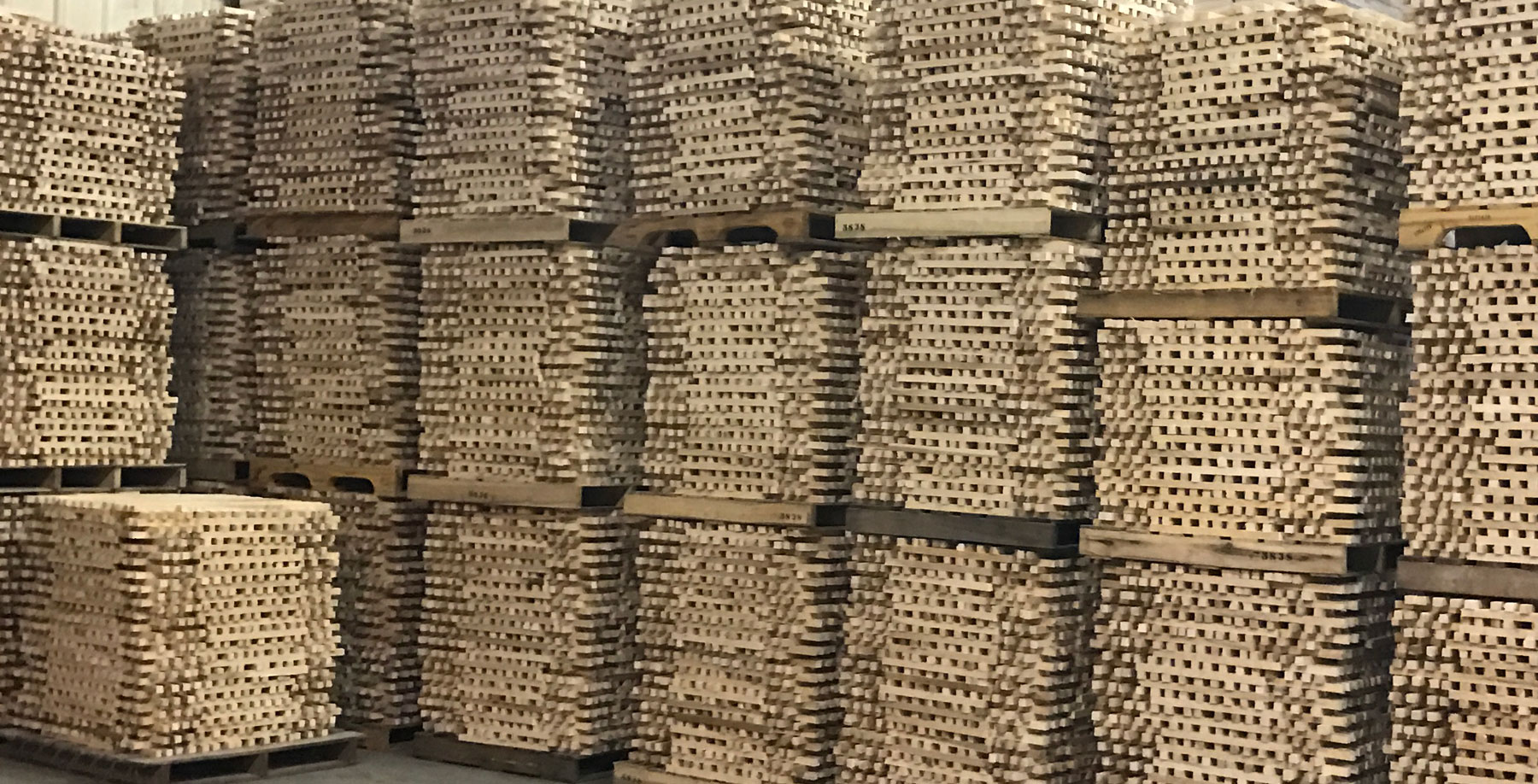 Wood-Stakes-Stacked-Drying.jpg