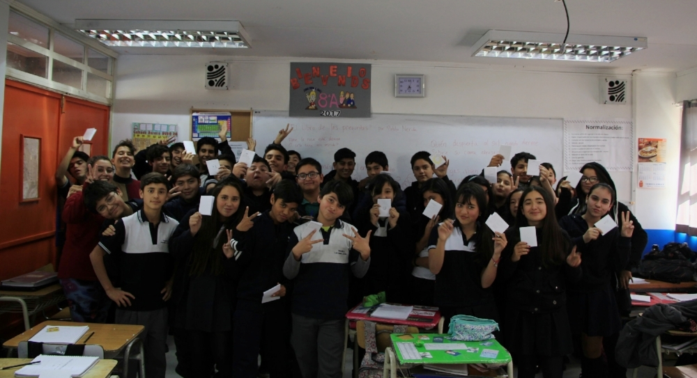 Students in the 8th grade at Luís Matte Larraín hold up their zines after the Space Lab workshop.