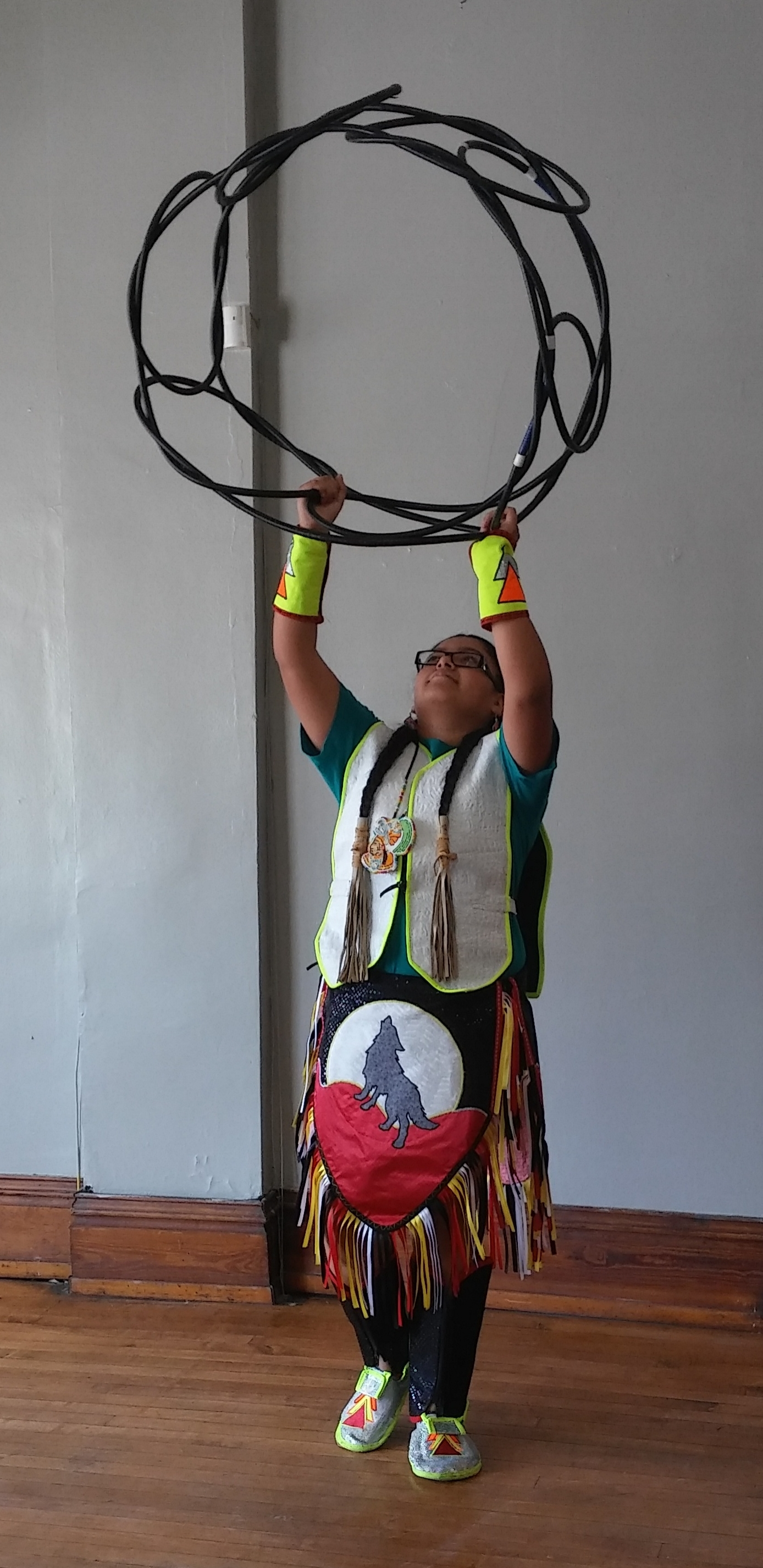 One of our young residents performing a native american hoop dance.