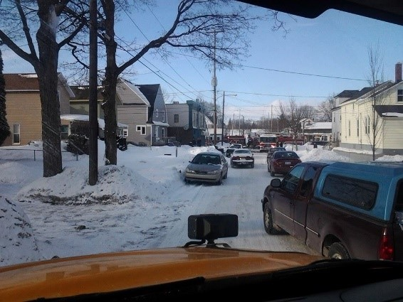 This photo was taken by resident Luci Anderson of Fire Trucks that were unable to respond quickly to a business fire (Sam's Party Store) on 2/27/2014 due to cars being parked on both sides of the street.