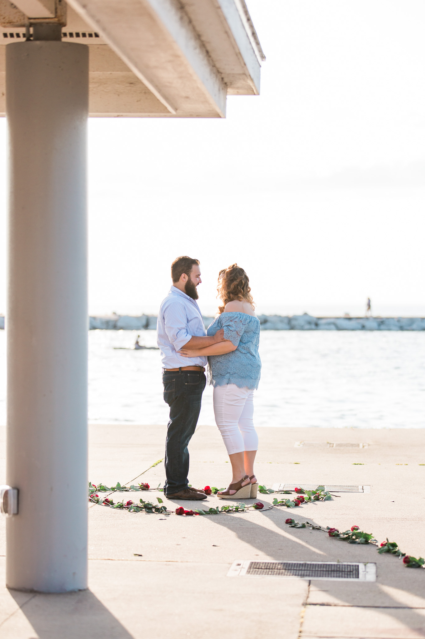 Romantic Petoskey Michigan Proposal on the Pier with Rose Trail | How He Asked | She Said Yes | Laurenda Marie Photography