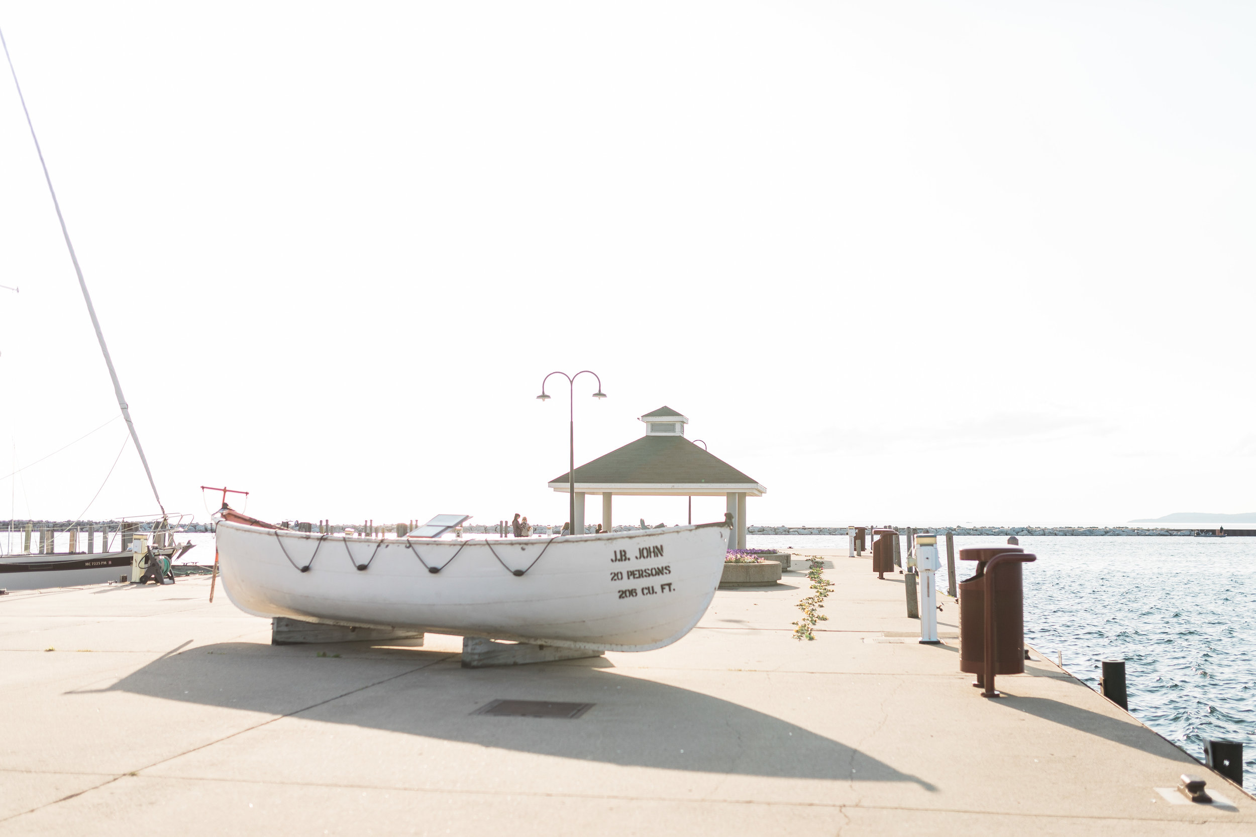 Romantic Petoskey Michigan Proposal on the Pier | How He Asked | She Said Yes | Laurenda Marie Photography