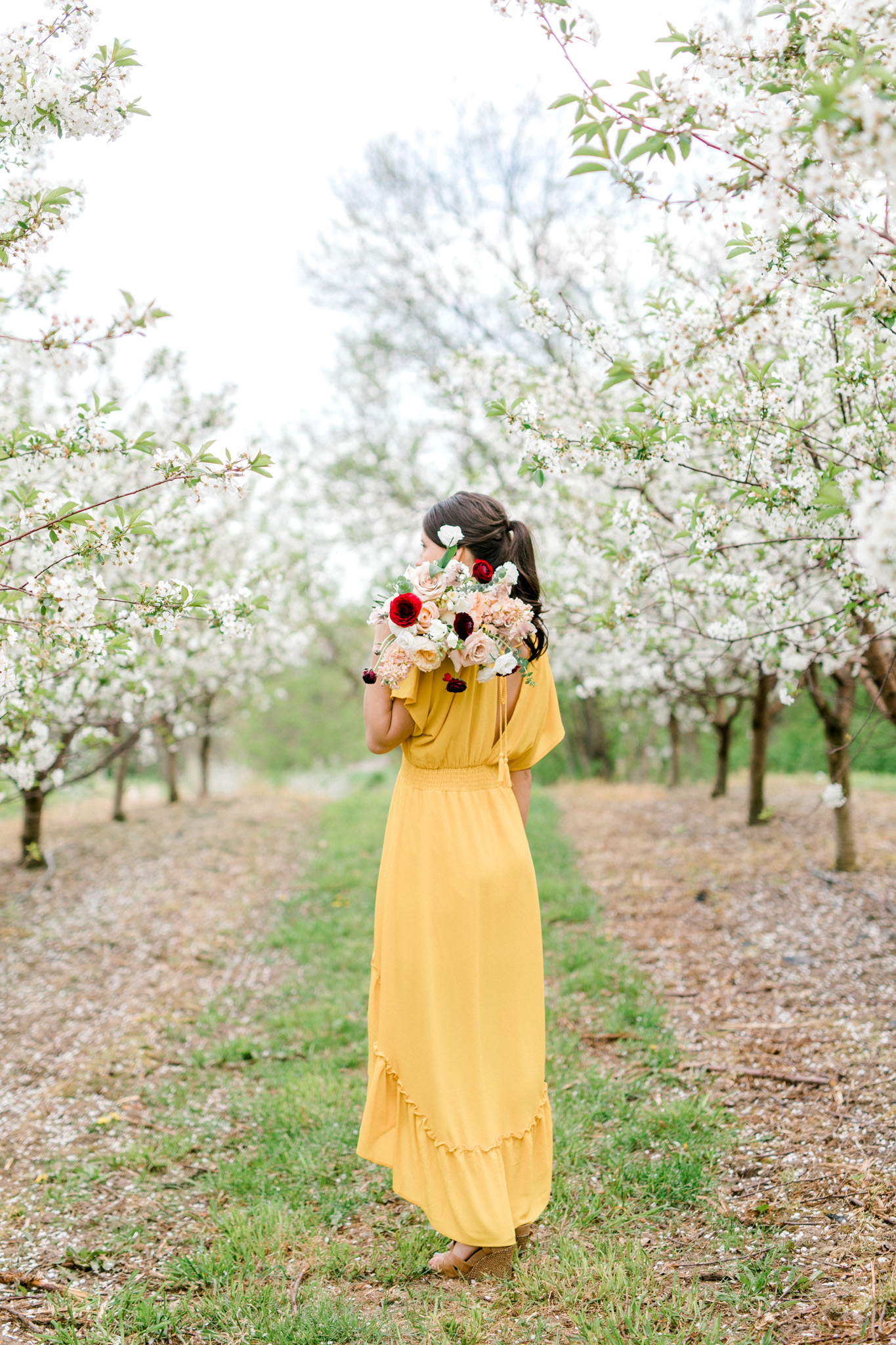 Spring Apple Blossom Engagement Session at the Orchard | Engagement Bouquet | Mustard Yellow Dress | What to Wear to Your Engagement Session | Grand Rapids Wedding Photographer