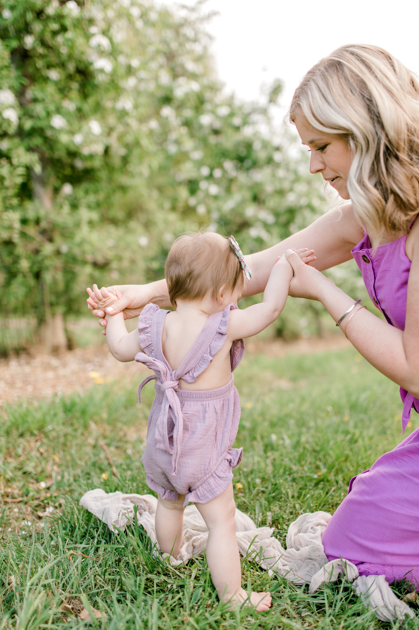 Baby Girl One Year Birthday Session at the Orchard | Spring Apple Blossom Session | Lifestyle Photography | Light & Airy Photography | West Michigan Photographer