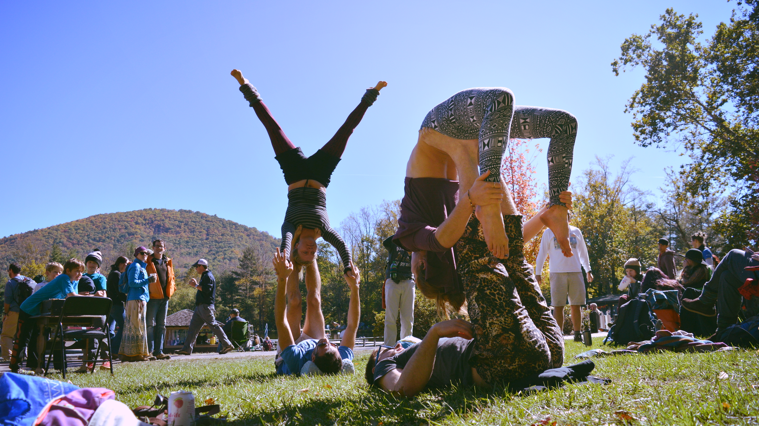 Group acro yoga at Lake Eden Arts Festival