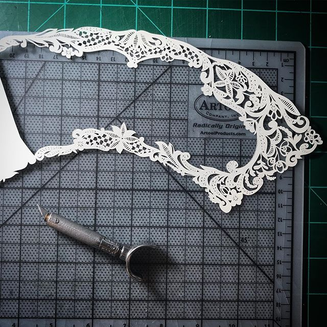 Halfway done cutting the lace for my next piece. This one is going to be rather different for me, but I'm enjoying the challenge!  #wip #paper #paperart #papercrafts #papercut #papercutting #papercuttingartist #lace #handfan #paperfauna