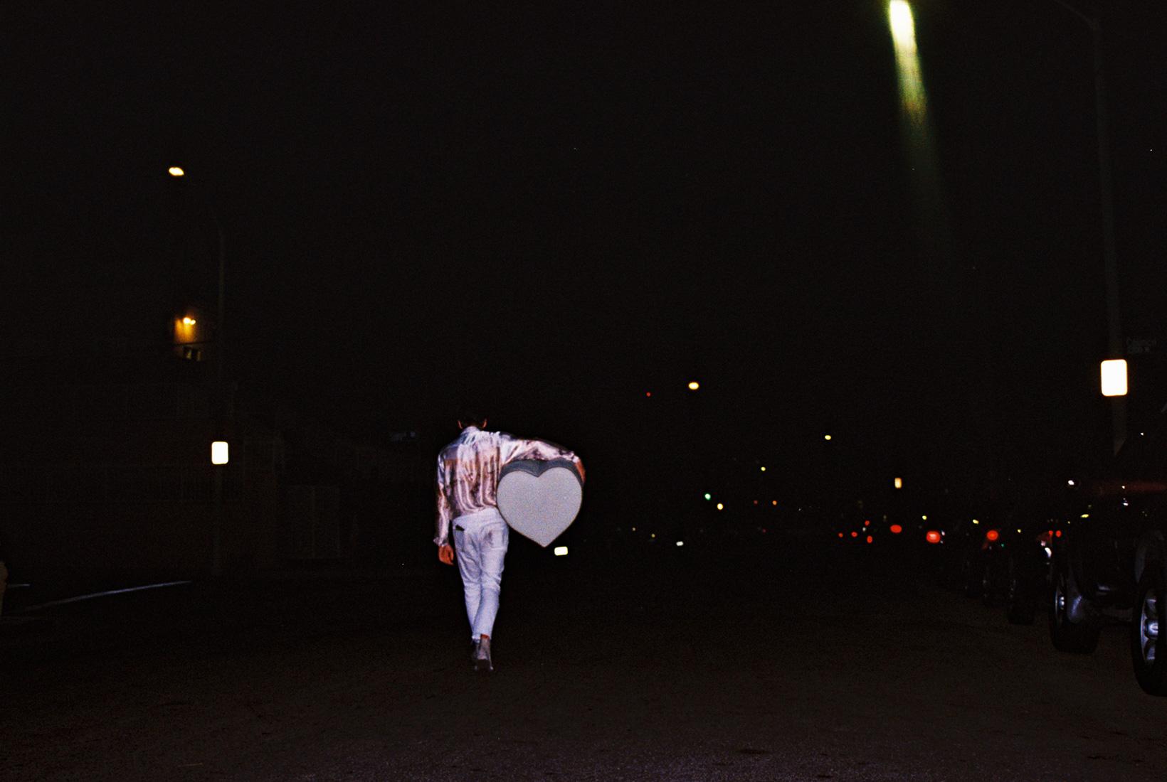 Garrett bringing home ottoman after a photo shoot