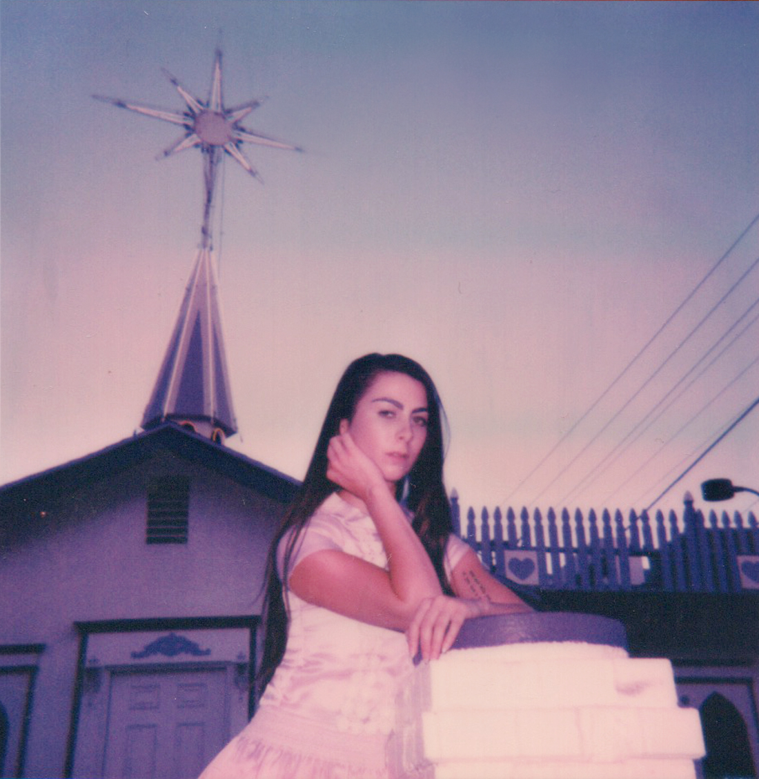 Polaroid of Cara in front of the Purple Chapel