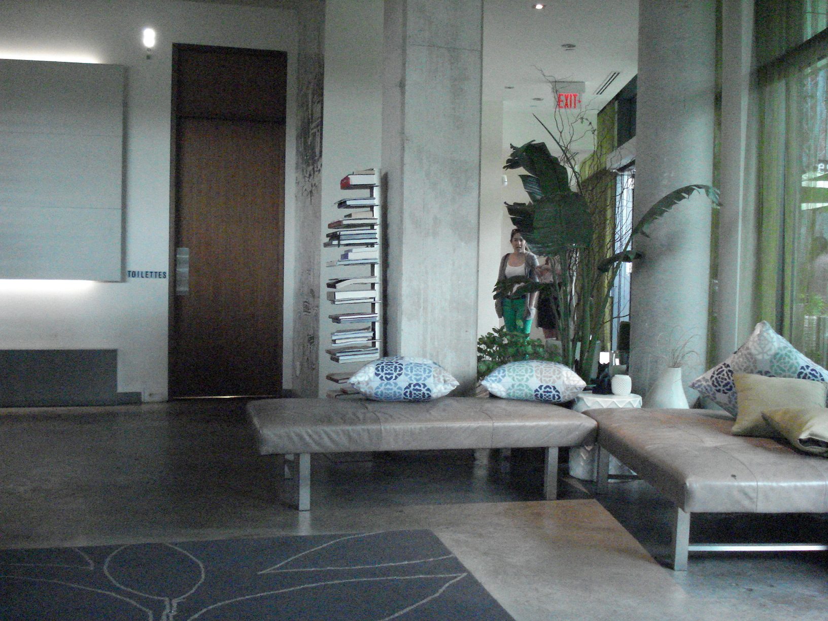 Picture of interior. Open floor space with low benches.